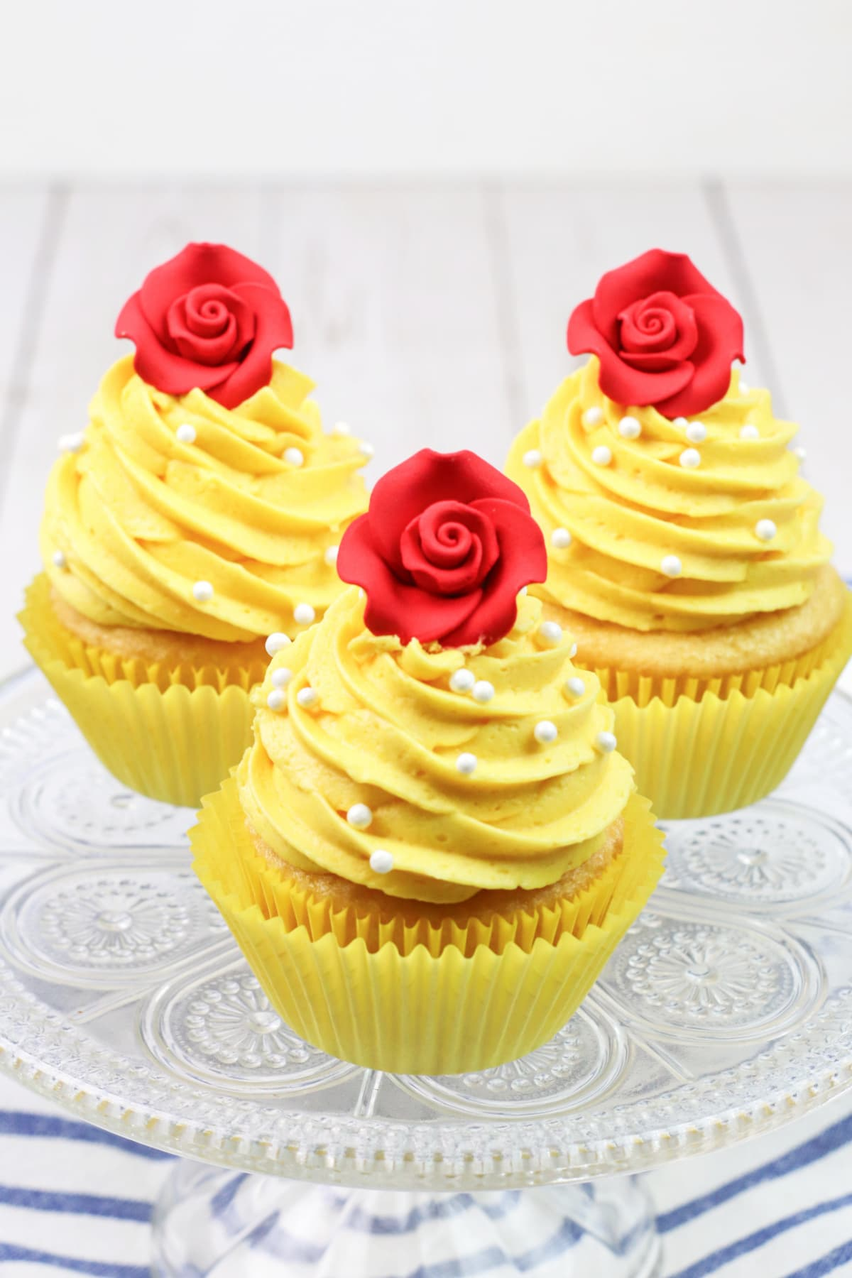 Beauty And The Beast cupcakes on glass plate