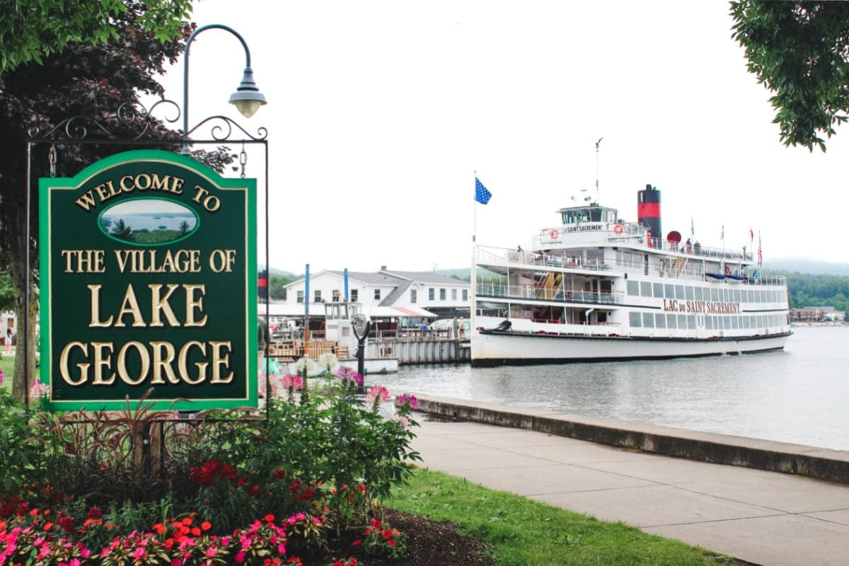 Lake George Village Sign with boat in background