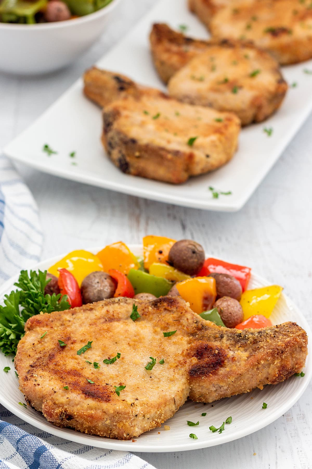 Shake and bake pork chop on a plate
