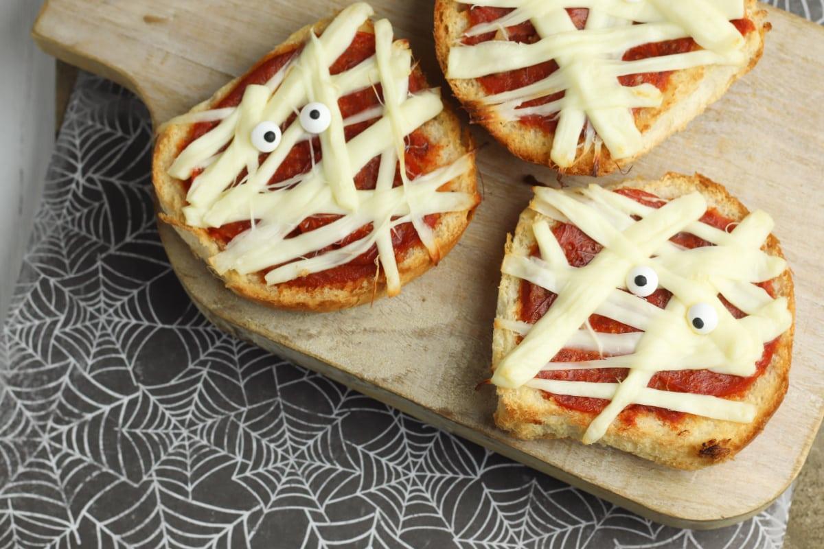 Mummy Pizzas wth spiderweb napkin