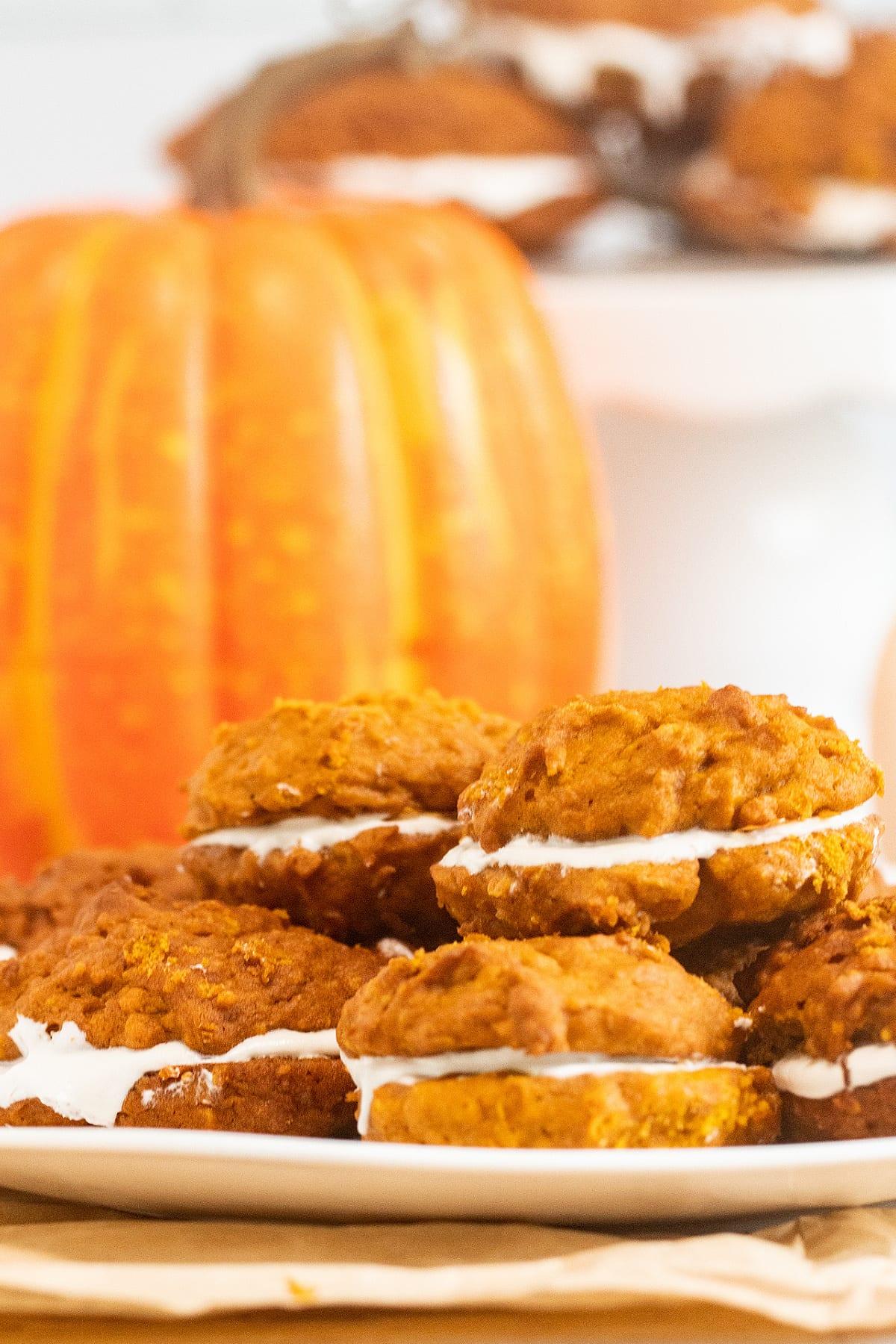 Pumpkin whoopie pies on plate