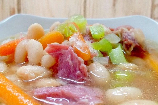 This Crockpot Ham and Beans recipe is the perfect use for leftover ham bone, but is delicious with diced ham, too! Throw this family-friendly dinner idea in your slow cooker on a cold day for an easy and hearty meal!