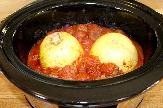 This Crock Pot Spaghetti Squash and Meatballs is incredibly easy and a low carb alternative to traditional spaghetti and meatball recipes!