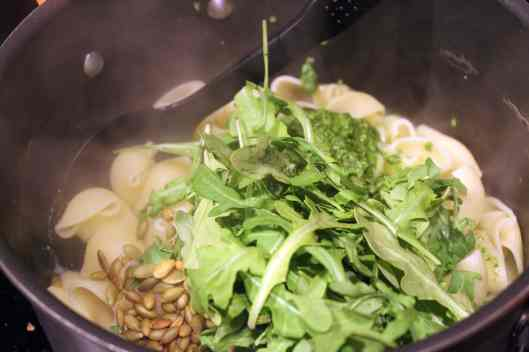 Add arugula and extra pepitas to pasta