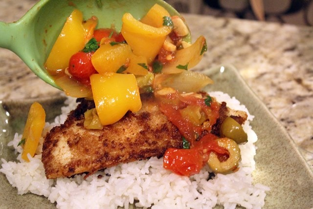 Top fish with sauce