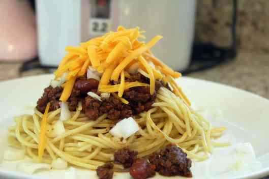 Spaghetti topped with chili and cheese