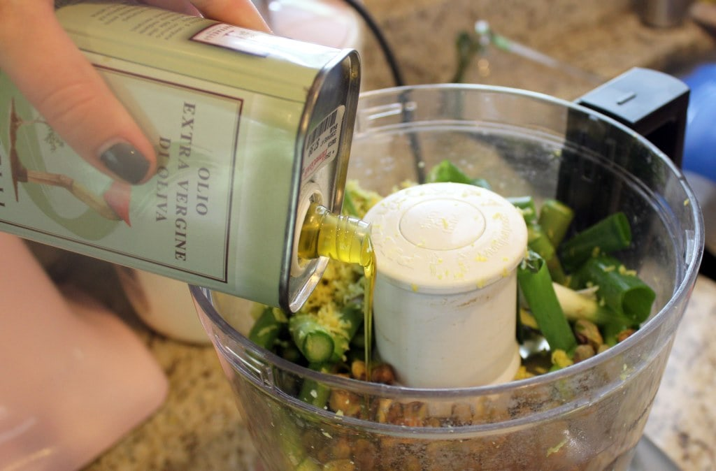 Add olive oil to pesto
