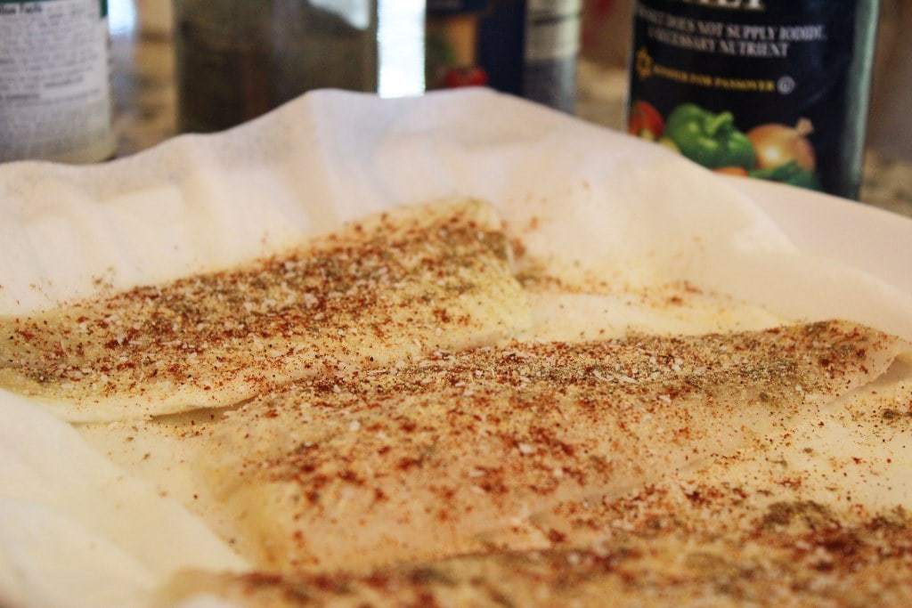 Sprinkle seasoning all over fish