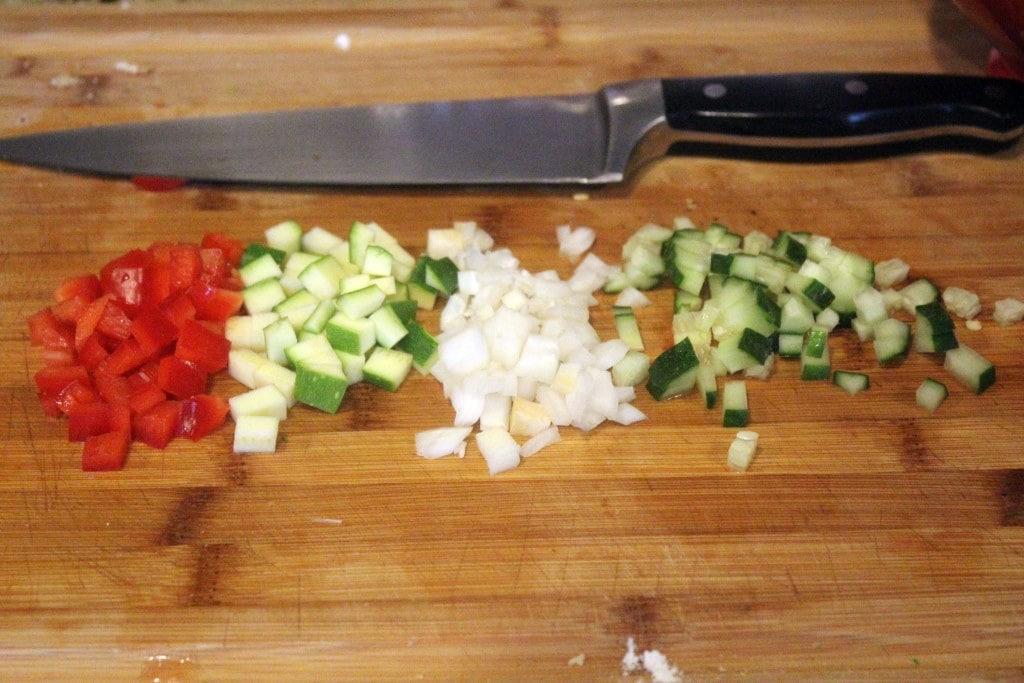 Finely chop extra veggies for topping