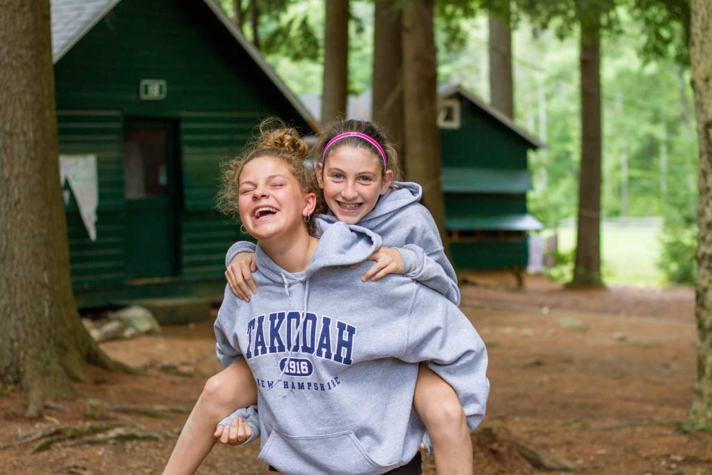 YMCA Camp Takodah friends piggyback