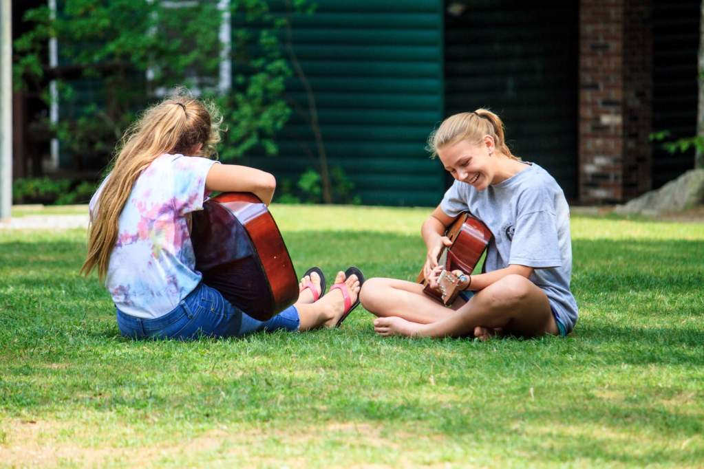 Camp Takodah - girls playing guitar