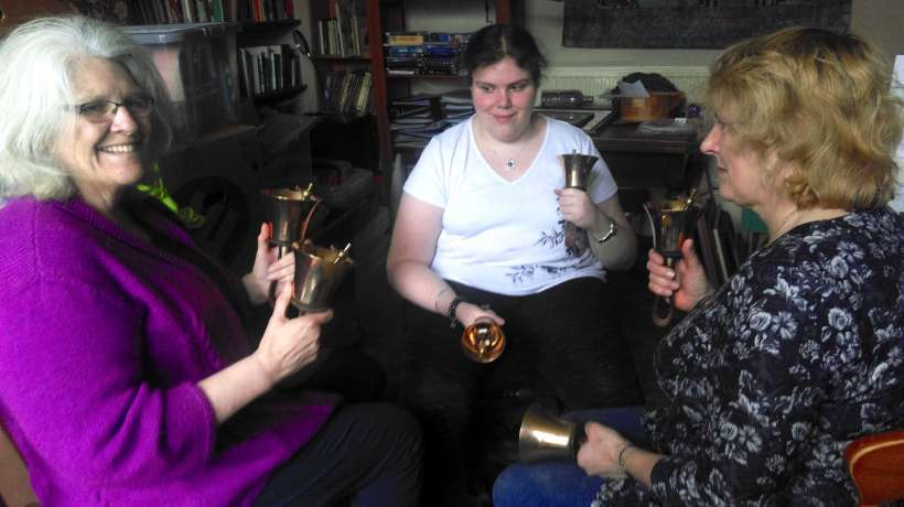 Rebecca Legowski ringing handbells - with 2 other ladies also with their handbells