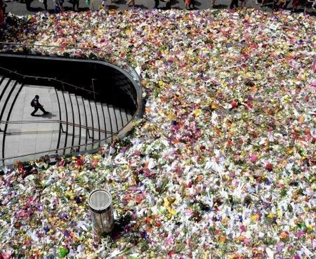 Image: A sea of flowers covers Martin Place in memory of Tori Johnson and Katrina Dawson who lost their lives in the Sydney Siege