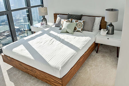 Bedroom with walnut bed and white nightstands