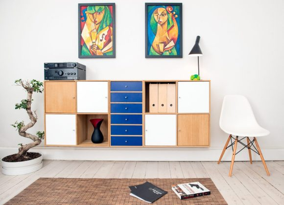 A living room console with multiple forms of storage including drawers, shelves, and box inserts.