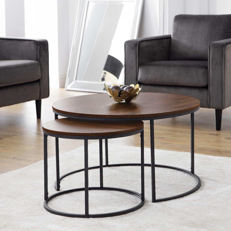 round dark wood nest of coffee tables with black metal base julian bowen bellini