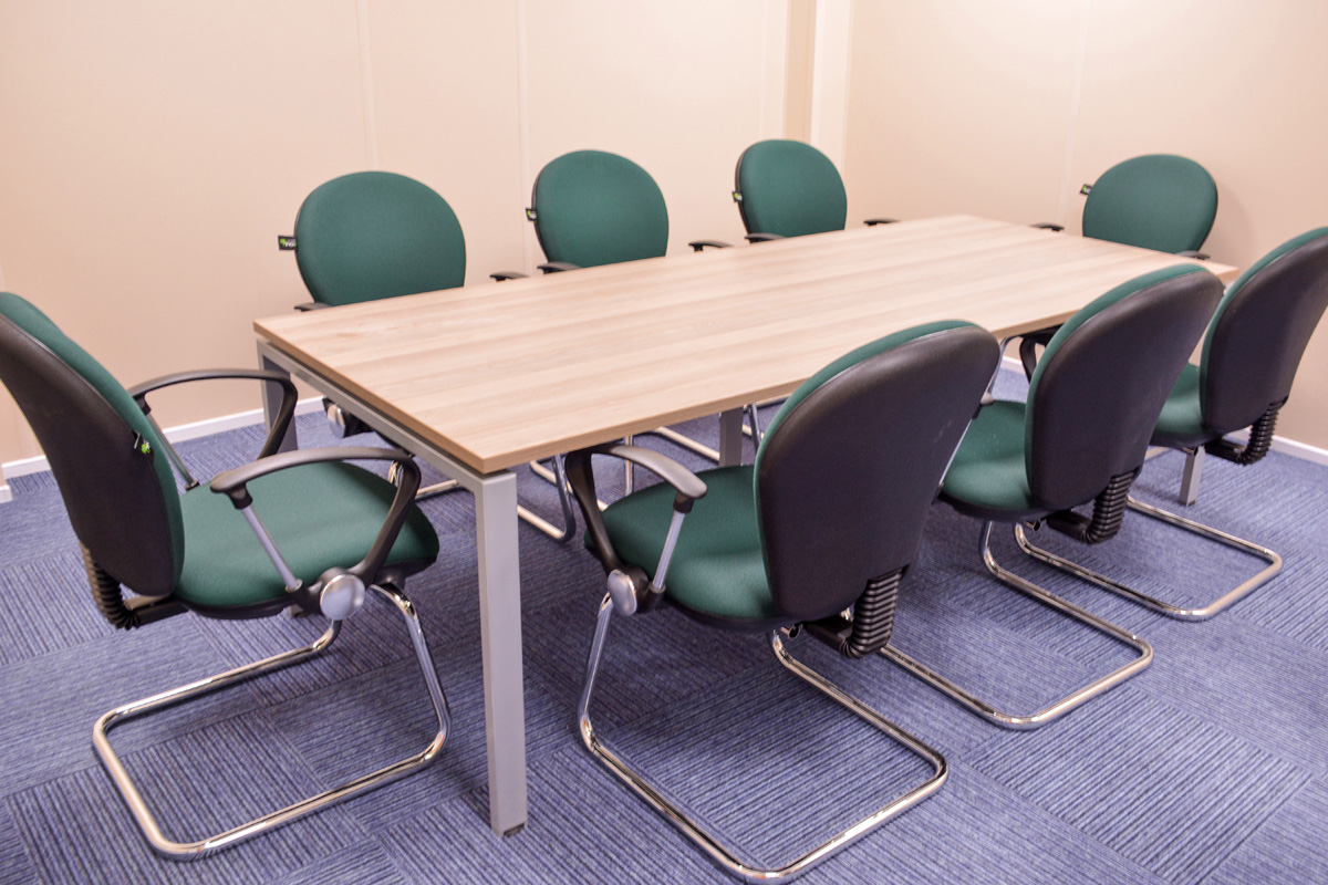meeting-room-setup-furniture-wall-clock-coatstand-hook-board-room