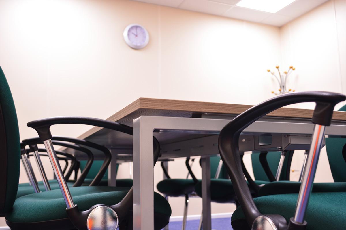 meeting-room-setup-furniture-wall-clock-coatstand-hook