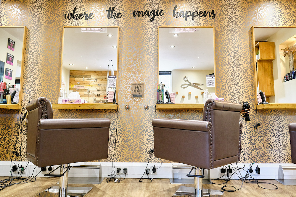 Inside Fusion Hair Co salon with the hairdressing chairs below the mirror.