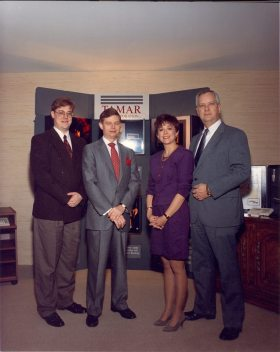 Tamar Corporation: Tom Tamarkin flanked by the design engineers in 1992