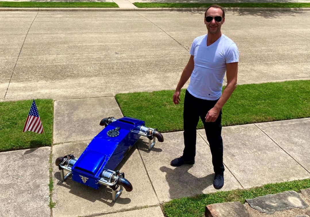 Alex Taits (CEO & Founder) of FusionFlight standing next to the AB6 JetQuad drone.