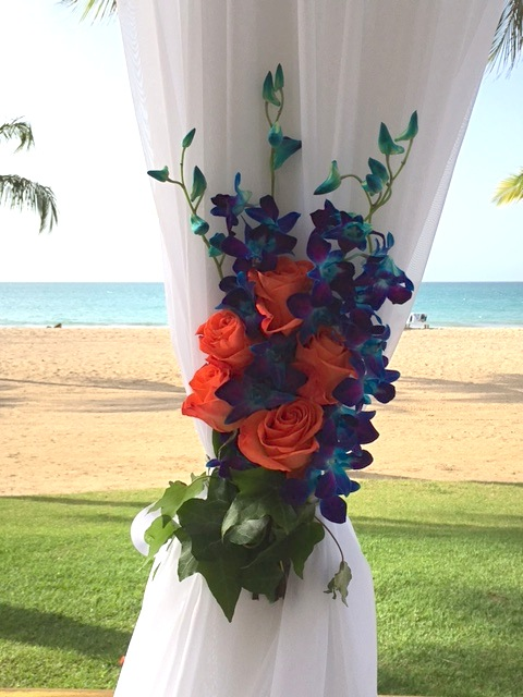 coral roses and blue dendrobium orchid side tie