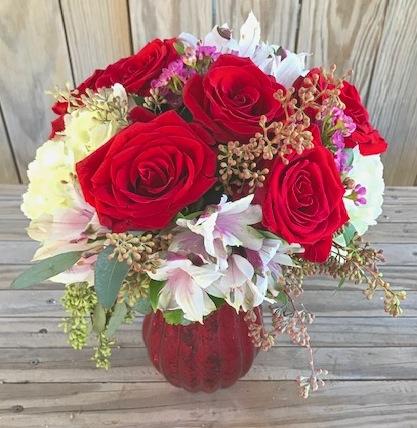 "Elegant mercury glass vase houses this Vintage Inspired red rose design. Flowers include 1/2 dozen premium red roses, hydrangeas, astromerias, eucaliptus. Approx. 16x10"" Price: $74"