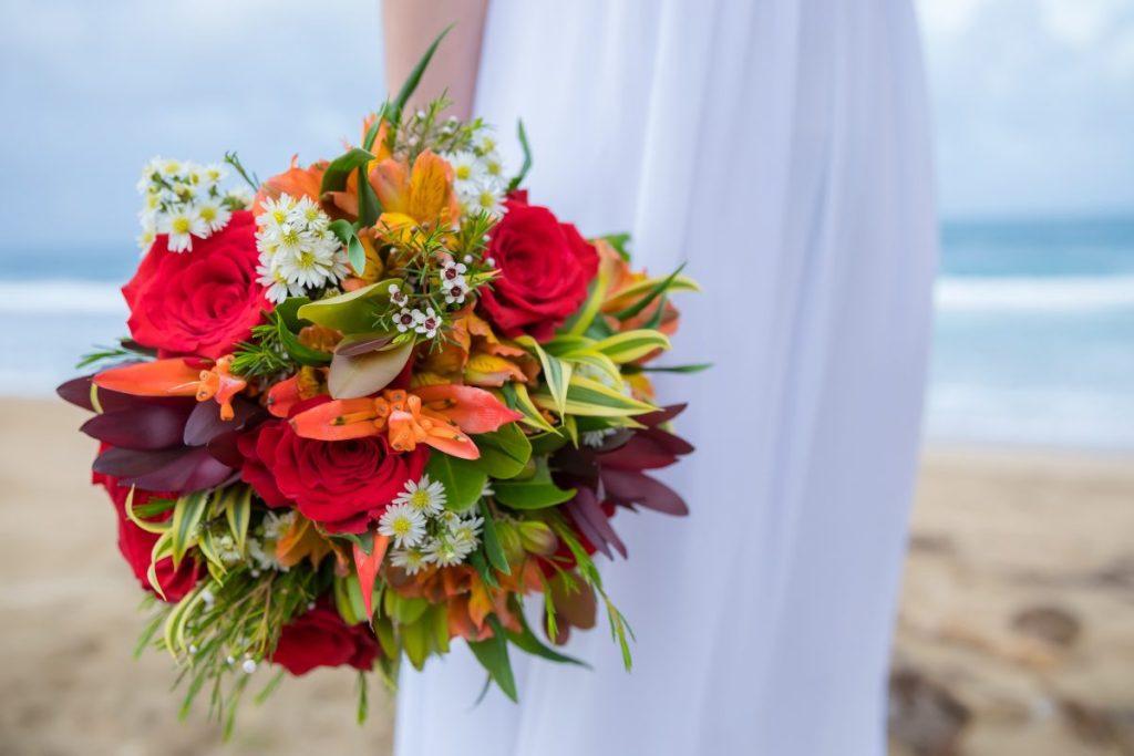 Small tropicals w/red roses & orange astromerias