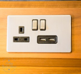 Clever electric socket with USB chargers at the Amba Hotel Charing Cross