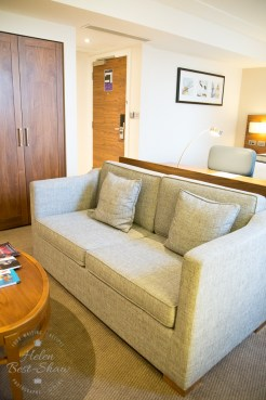 Comfy sofa in room at the Amba Hotel Charing Cross