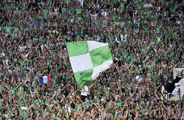 Saint-Etienne's supporters cheer during the Champions League third qualifying football match between Saint-Etienne (ASSE) and Athens (AEKFC) on July 28, 2016, at the Geoffroy Guichard Stadium in Saint-Etienne, central France. / AFP / JEAN-PHILIPPE KSIAZEK (Photo credit should read JEAN-PHILIPPE KSIAZEK/AFP/Getty Images)