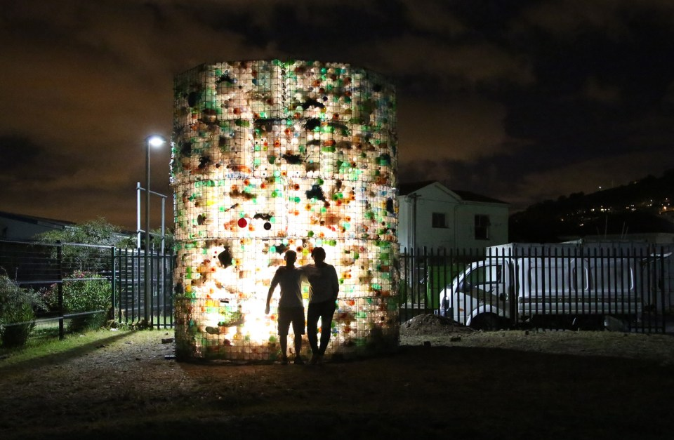 The architectural potential of plastic waste showcased through the night lighting of the installation.