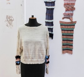 A creme jumper on a mannequin in a fashion studio