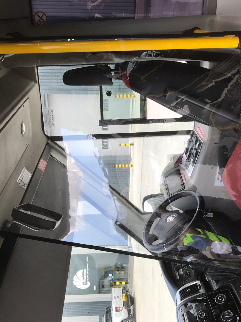 Canvasman Ltd's transparent screen fitted to the driver cabin of a bus