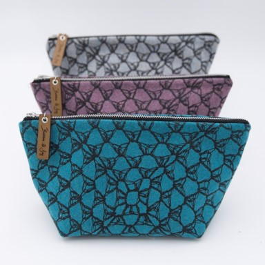 Blue, purple and grey knitted bags with black pattern from Bobbie & Joy
