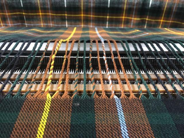 Loom at Joshua Ellis weaving check design