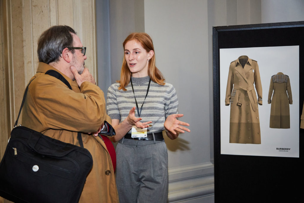 Hannah Dean talks through designs from the Burberry 'hackathon' at a special event hosted by UK Research and Innovation in 2019