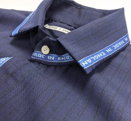 Close-up of collar of blue pinstriped shirt by Danielle Elsener