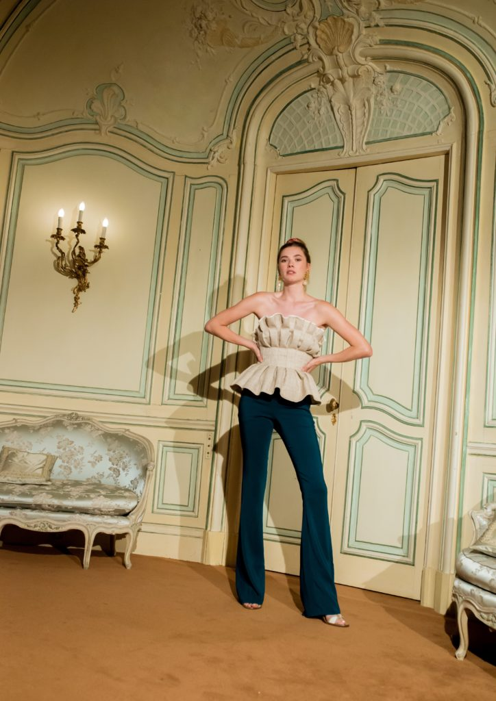 Haute couture creme-coloured bustier worn by a model inside a stately home