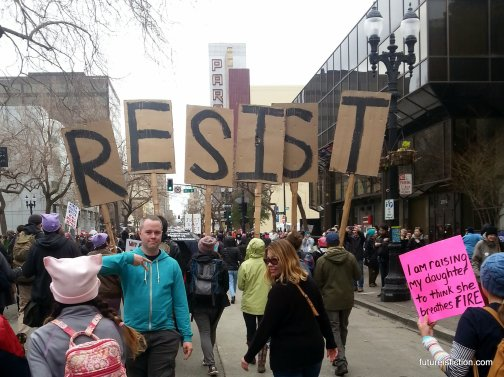 Protestors at Oakland Women's March carrying letters that collectively spelll RESIST