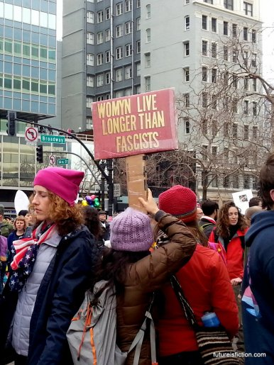 Protest sign at Women's March in Oakland: Womyn live longer than fascists