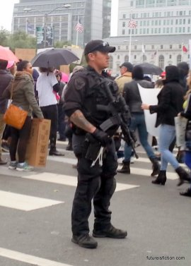 cop with automatic weapon at SF Women's March