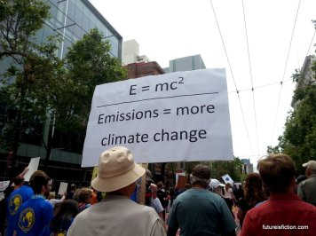 protest sign: E=MC^2/ Emissions = More Climate Change