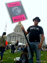 "Protest sign with photo of the earth captioned ""This photo brought to you by science"""
