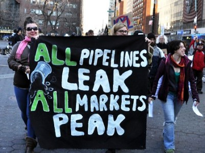 climate justice sign: All pipelines leak, all markets peak