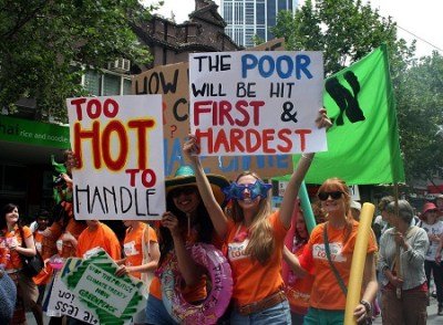 Climate change protest signs: Too hot to handle, the poor will be hit first and hardest