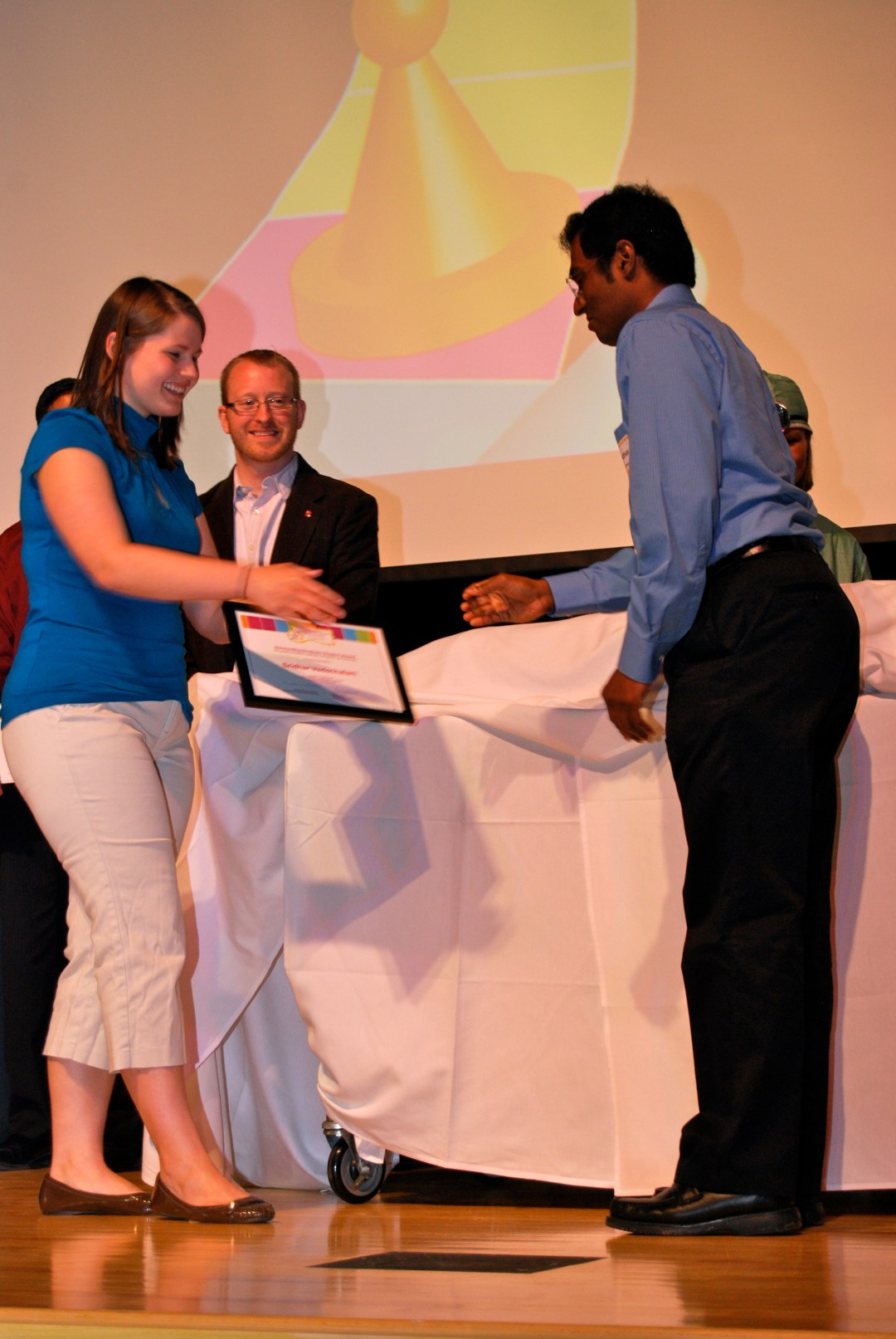 Sri receiving the Outstanding Graduate Student Award for Student Leadership at Ohio State