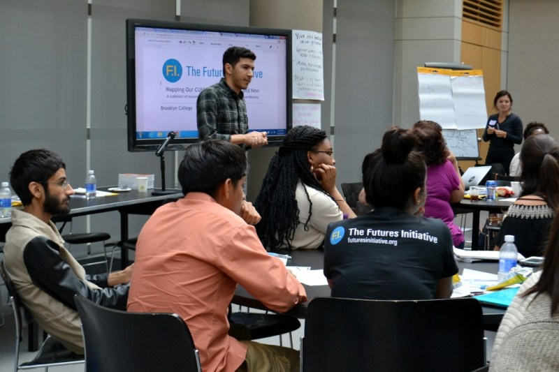 Mike Rifino leads the group in discussing superpowers and how they can be used in mentoring others.