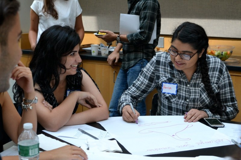 Mentors begin to sketch out their prototypes for their mentoring tools.