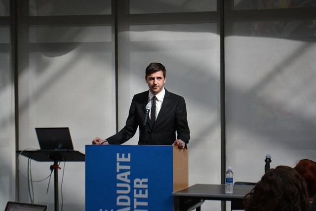 Kalle Westerling speaking at podium